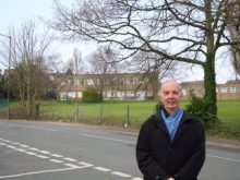 Cllr Roger Coales pictured in front of the old Courtney School