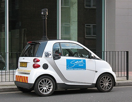 A small car fitted with a roof-mounted camera for parking enforcement purposes.
