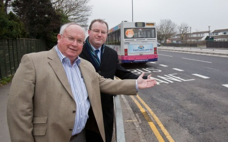 Cllr Brian Allinson (left) beside a bus lane at Aztec West.