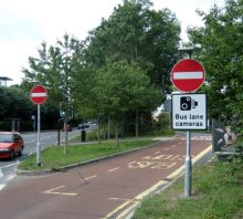 Bus lane enforcement camera signage at the junction of New Road and Brierly Furlong in Stoke Gifford, Bristol.
