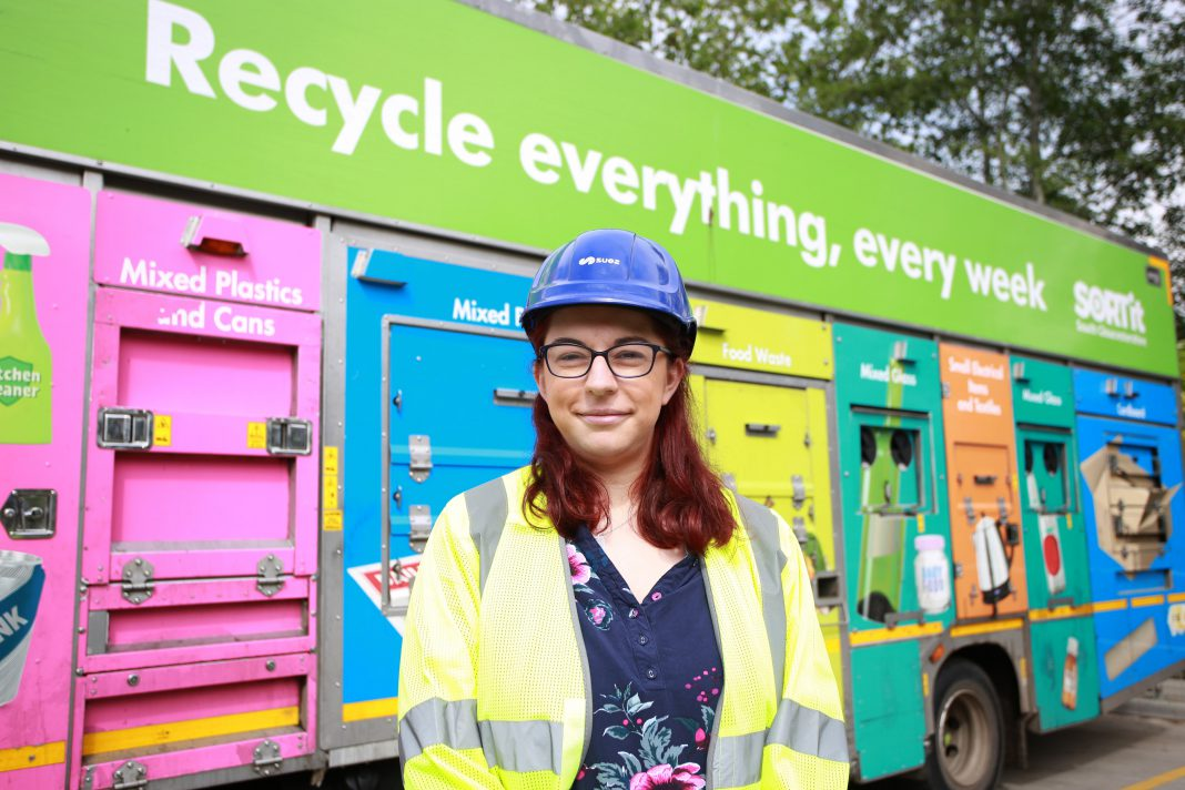 Photo of Cllr Rachael Hunt standing in front of a recycling collection vehicle.